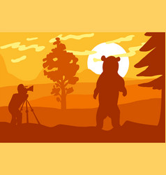 Photographer photographs bear in nature vector