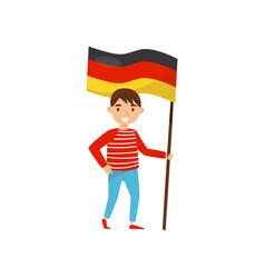 Boy holding national flag of germany design vector