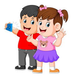 two little children are taking a perfect selfie vector image