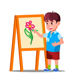 Little boy draws on paper with colored pencils vector