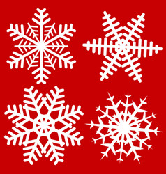 set of 4 simple isolated snowflake on red vector image