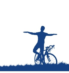 Silhouette of a cyclist on the grass vector