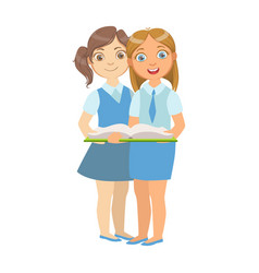 Two girls in school uniform standing reading a vector