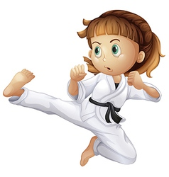 A brave young girl doing karate vector image