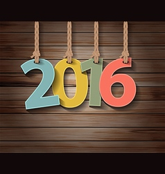 Happy new year 2016 paper greeting card on wood vector image vector image