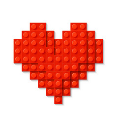 red heart made of plastic construction blocks vector image