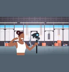 Woman fitness blogger shooting selfie video vector