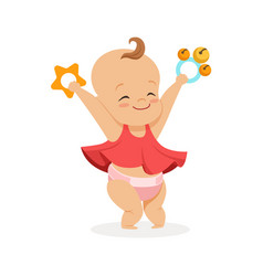Cute smiling baby girl playing with rattles vector