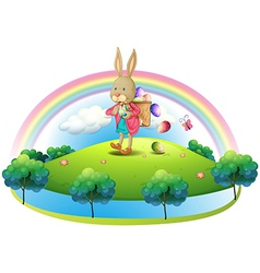A bunny with a basket of eggs vector image vector image