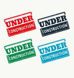 under construction sign in four colors vector image vector image