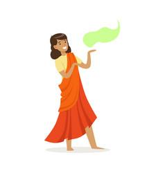 Beautiful indian woman in an orange sari dancing vector