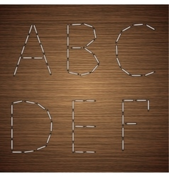 modern staples alphabet on wooden vector image