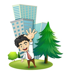A happy businessman near the pine tree vector