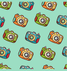 Seamless pattern with hand drawn photo camera vector