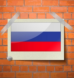 Flags Russia scotch taped to a red brick wall vector