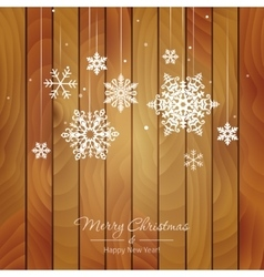 White snowflakes on a wooden background vector image vector image