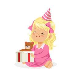 Cute smiling baby girl wearing a pink party hat vector
