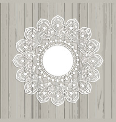 lace style mandala on a wooden background vector image