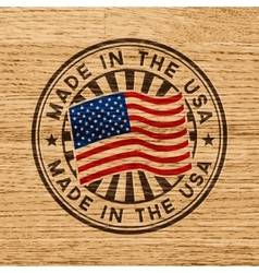 Made in the usa stamp on wooden background vector