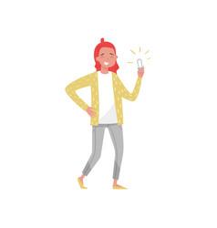 smiling girl holding an energy saving light bulb vector image