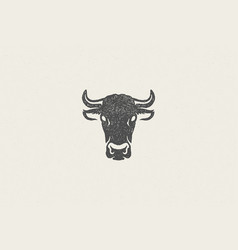Black cow head silhouette with horns designed vector