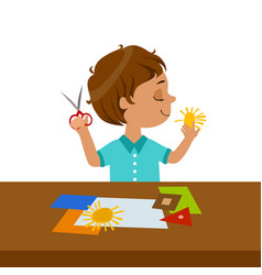 Boy cutting sun shape for paper applique vector