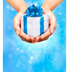 Hands holding gift boxes vector image vector image