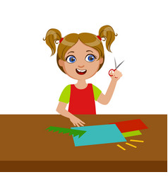 Girl cutting grass shape for applique elementary vector
