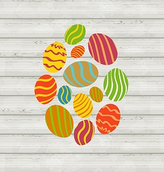 Easter ornamental eggs on wooden background vector image vector image