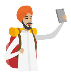 Hindu traveler man with backpack making selfie vector