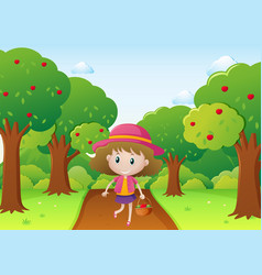 Little girl walking in apple orchard vector