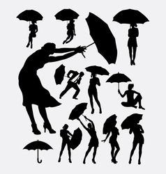People with umbrella silhouette vector