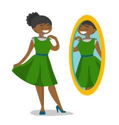 Woman looking in the mirror in the dressing room vector