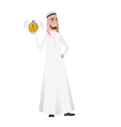Muslim businessman holding alarm clock vector