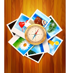 Travel photos and compass on wood background vector