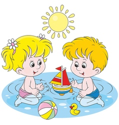 Children playing in water vector image