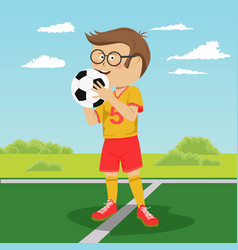 teenager boy poses with soccer ball on field vector image