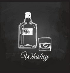 Hand sketched whiskey bottle and glass vector