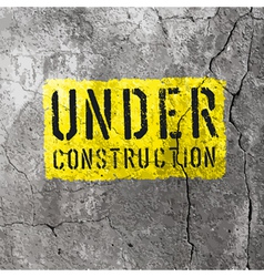 Under construction sign on concrete wall texture vector