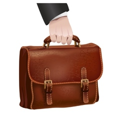 Businessman hand holds leather briefcase vector