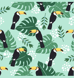 seamless pattern with toucan and leaves on blue vector image