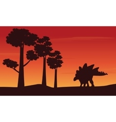 Silhouette of dinosaur stegosaurus on the hill vector image