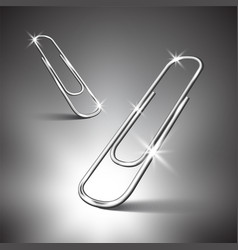 Two paper clips on gray background vector