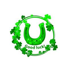 Green horseshoe and clover leaves for st patricks vector