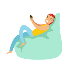 Guy sitting on beanbag with smartphonepart of vector