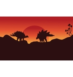 Silhouette of two stegosaurus on the cliff vector image vector image