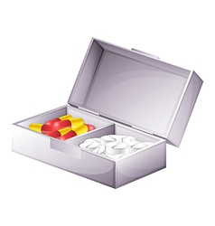 A medicine kit with capsules and tablets vector