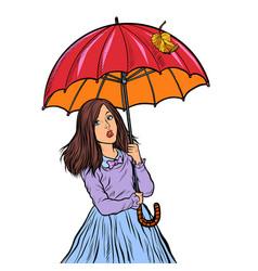 Autumn girl with umbrella vector