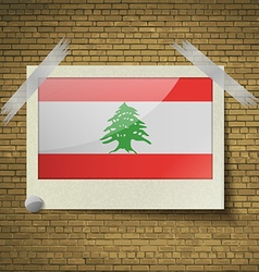 Flags Lebanon at frame on a brick background vector image