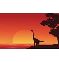 Silhouette of dinosaur brachiosaurus on riverbank vector